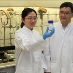Dr Yuan Yuan (left) is holding up the new antimicrobial material (white powder in bottle) with Dr Yugen Zhang (right).