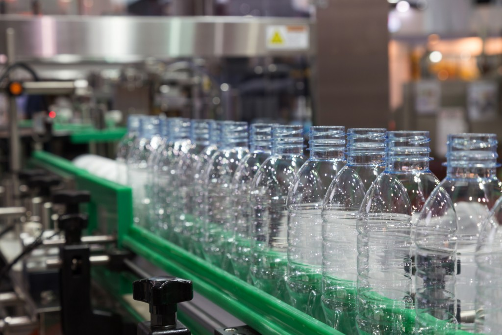 plastic bottle on factory line machine in the factory