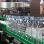 plastic bottle on factory line machine in the factory, bottle industry, bottle factory, bottle machine, plastic bottle in fatory line. selective focus